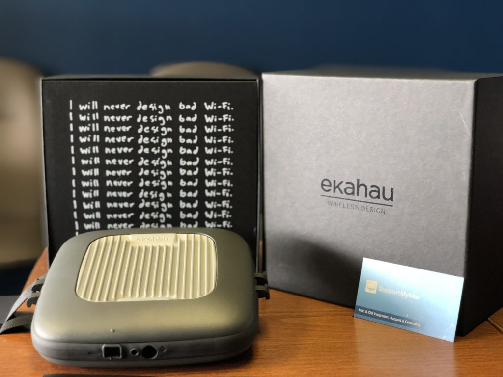 An Ekahau packaging with SupportMyMac business card, with booklet that says I will never design bad Wi-Fi