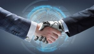A closeup photo of a caucasian person's arm in a business suit shaking hands with a robot in a business suit