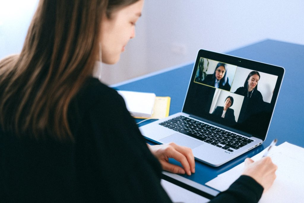 Three women using video call technology to work